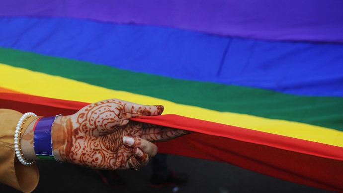 A gay rights activist holds a rainbow flag during a Rainbow Pride rally in Kolkata.(AFP Photo / Dibyangshu Sarkar)