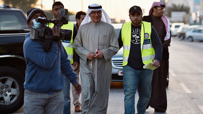 President of Bahrain's opposition Al Wefaq party's consultative council Jameel Kadhim (C) is arrested by police before taken to prison, outside party headquarters in Manama, January 14, 2015. (Reuters / Stringer)