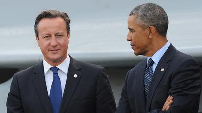 Britain's Prime Minister David Cameron (L) speaks with US President Barack Obama. (AFP Photo/Stefan Rosseau)