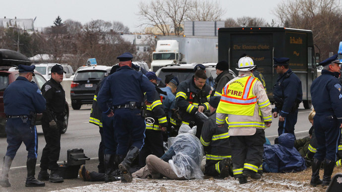 Police detain a group of protesters who blocked Interstate 93 southbound during the morning rush hour in Somerville, Massachusetts January 15, 2015. (Reuters/Brian Snyder)
