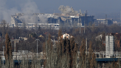 Smoke rises above a new terminal of the Sergey Prokofiev International Airport after the recent shelling (Reuters / Maxim Zmeyev)