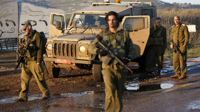 "Israeli troops patrol the Israeli-occupied sector of the Golan Heights on January 18, 2015. An Israeli helicopter carried out a strike today against ""terrorists"" in the Syrian sector of the Golan Heights who were allegedly preparing an attack on Israel, an Israeli security source said. (AFP Photo/Jalaa Marey)"