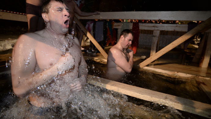Russian Orthodox Christians take chilling plunge to mark Epiphany (PHOTOS, VIDEO)