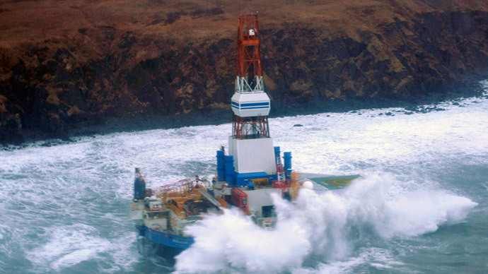 Waves crash over the conical drilling unit Kulluk where it sits aground on the southeast side of Sitkalidak Island, Alaska in this U.S.  (Reuters / Petty Officer 3rd Class Jonathan Klingenberg' / USCG / Handout)