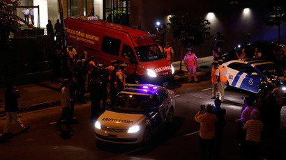 A vehicle of the Argentine Federal Police forensic unit carrying the body of Argentine prosecutor Alberto Nisman leaves his home in Buenos Aires January 19, 2015. (Reuters / Marcos Brindicci)