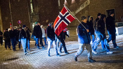 Supporters of the Norwegian wing of Germany's anti-Islamic Pegida movement hold national flags of Norway as they demonstrate on January 19, 2015 in Oslo. (AFP Photo / NTB Scanpix / Fredrick Varfgell)
