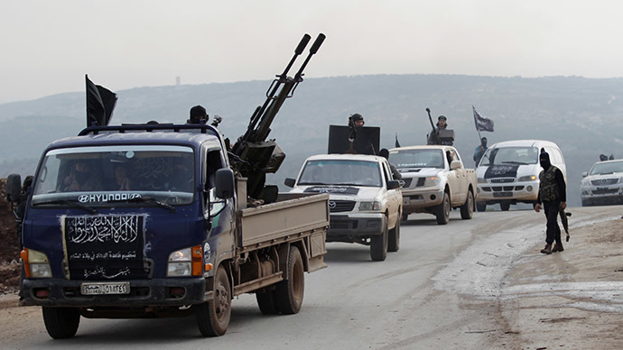 Members of al Qaeda's Nusra Front drive in a convoy as they tour villages, which they said they have seized control of from Syrian rebel factions, in the southern countryside of Idlib, December 2, 2014. (Reuters/Khalil Ashawi)