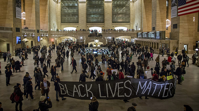 Demonstrators carry a banner through Grand Central Station during a protest against police violence towards minorities in New York January 15, 2015. (Reuters/Andrew Kelly)