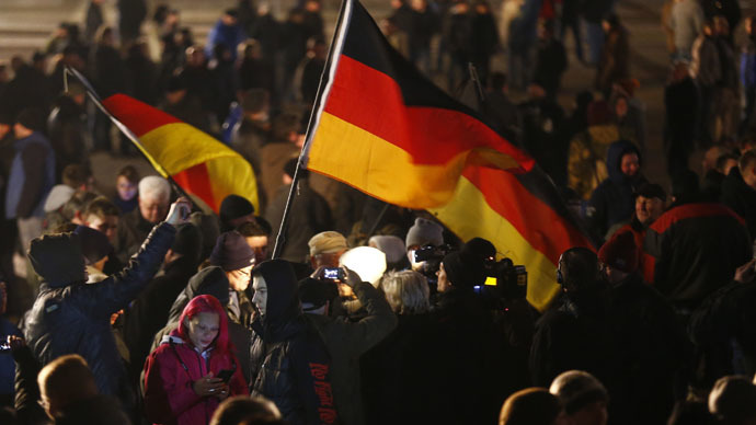People wave German national flags as they gather for a demonstration by LEGIDA, the Leipzig arm of the anti-immigrant movement  Patriotic Europeans Against the Islamisation of the West (PEGIDA) January 21, 2015. (Reuters/Hannibal Hanschke)