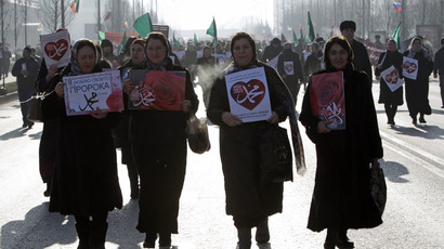 Women attend a rally to protest against satirical cartoons of prophet Mohammad, in Grozny, Chechnya January 19, 2015. (Reuters/Eduard Korniyenko)