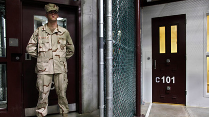 A Guantanamo guard stands inside a doorway at Camp 6 detention facility at Guantanamo Bay U.S. Naval Base, Cuba (Reuters/Brennan Linsley)