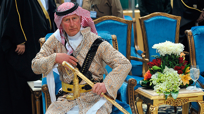 Britain's Prince Charles, wearing a traditional Saudi attire, attends the traditional Saudi dance, known as 'Arda', which was performed during Janadriya culture festival at Der'iya in Riyadh, February 18, 2014 (Reuters / Fayez Nureldine)