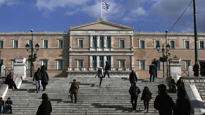People make their way in central Syntagma Square as the parliament building is pictured in the background in Athens. (Reuters/Alkis Konstantinidis)