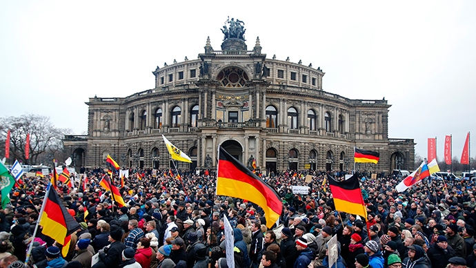 Members of the movement of Patriotic Europeans Against the Islamisation of the West (PEGIDA) hold flags and banners during a PEGIDA march in Dresden, January 25, 2015 (Reuters / Hannibal Hanschke)