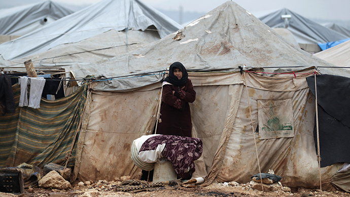 An internally displaced inside Al-Karameh refugee camp beside the Syrian-Turkish border in Northern Idlib countryside. (Reuters / Khalil Ashawi)