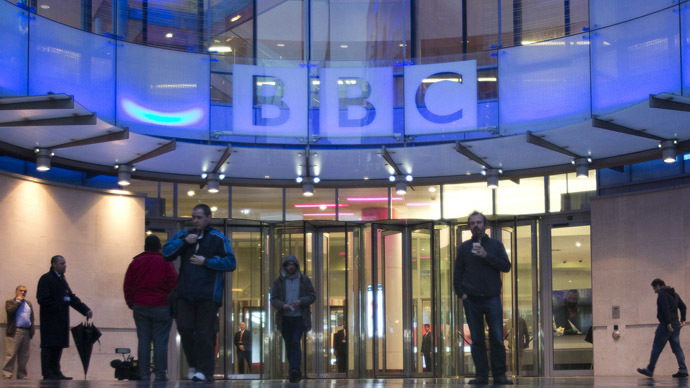 People arrive at, and leave, the BBC headquarters at New Broadcasting House in central London  (Reuters / Neil Hall)