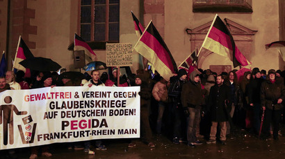 Supporters of the movement of Patriotic Europeans Against the Islamisation of the West (PEGIDA) gather outside St. Catherine's Church in Frankfurt, January 26, 2015. (Reuters/Kai Pfaffenbach)
