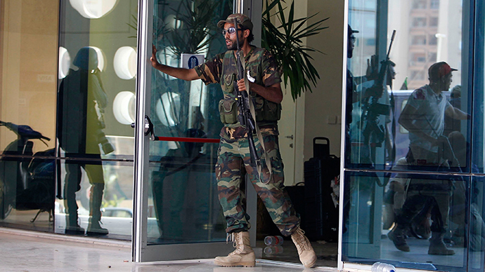 ISIS-affiliated gunmen storm Tripoli hotel, blow up car bomb & kill guards