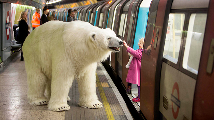 Mind the bear! 8-foot Arctic giant roams London Tube & streets... to promote TV series