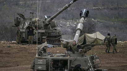 Israeli soldiers are seen next to mobile artillery units near the border with Syria in the Golan Heights January 27, 2015. (Reuters/Baz Ratner)