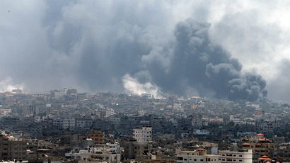 Smoke rises during what witnesses said were heavy Israeli shelling at the Shejaia neighbourhood in Gaza City July 20, 2014.(Reuters / Mohammed Salem)