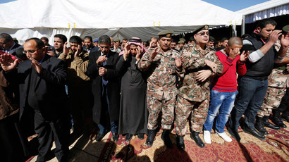 Saif al-Kasaesbeh (C), father of Jordanian pilot Muath al-Kasaesbeh, prays at the headquarters of the family's clan in the city of Karak February 4, 2015.(Reuters / Muhammad Hamed)