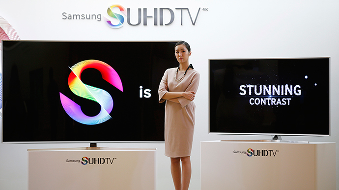 A model stands next to Samsung Electronic's S'UHD smart television sets during its launch event in Seoul February 5, 2015 (Reuters / Kim Hong-Ji)