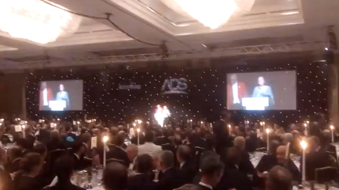 Pregnant activist crashes glitzy arms industry dinner, urges guests 'consider career change'