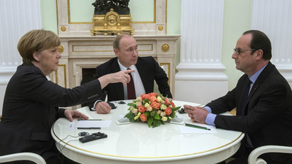 February 6, 2015. Russian President Vladimir Putin, center, Federal Chancellor of Germany Angela Merkel and President of France Francois Hollande during a meeting in Kremlin. (RIA Novosti/Sergey Guneev)