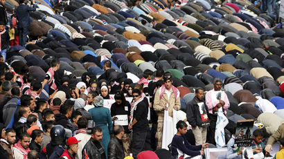 Muslims perform Friday prayers along a street outside al-Husainy mosque before a march in downtown Amman February 6, 2015. (Reuters/Muhammad Hamed)