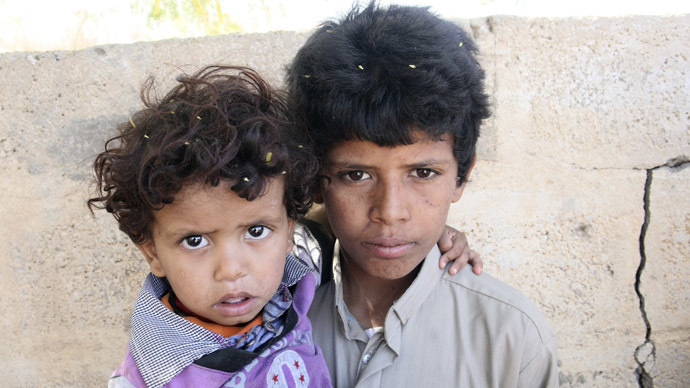 Mohammed Saleh Qayed Taeiman (R) poses for a photo with his younger brother outside their family's house in Marib province, Yemen  in this October 29, 2013 photo. (Reuters/Faroq al-Shaarani)
