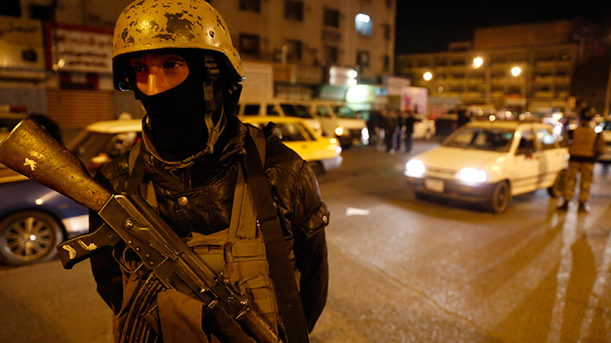 A member of Iraq's security forces stands guard at Tahrir Square in Baghdad February 8, 2015. (Reuters / Thaier Al-Sudani)