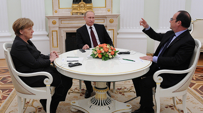 Russian President Vladimir Putin, Federal Chancellor of Germany Angela Merkel and President of France Francois Hollande, right, during a meeting in Kremlin February 6, 2015. (RIA Novosti / Michael Klimentyev)