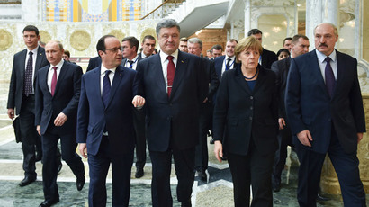 Belarus' President Alexander Lukashenko (R), Russia's President Vladimir Putin (2nd L), Ukraine's President Petro Poroshenko (C, front), Germany's Chancellor Angela Merkel (2nd R) and France's President Francois Hollande (front L) walk as they take part in peace talks on resolving the Ukrainian crisis in Minsk, February 11, 2015.(Reuters / Mykola Lazarenko)
