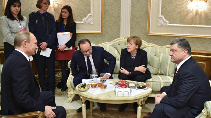 Foreground, from left: Russian President Vladimir Putin, French President Francois Hollande, German Chancellor Angela Merkel, and Ukrainian President Petro Poroshenko at Independence Palace in Minsk during the peace talks on Ukraine, February 11, 2015. (RIA Novosti/Nikolay Lazarenko)