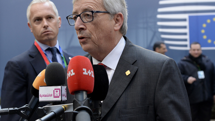 European Commission President Jean-Claude Juncker speaks to journalists as he arrives ahead of the European Council Summit at the European Union (EU) Headquarters in Brussels on February 12, 2015. (AFP Photo / Thierry Charlier)