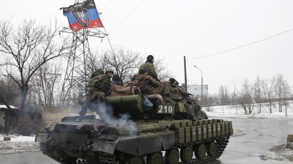 Rebels drive an armoured vehicle on the outskirts of Donetsk January 22, 2015. (Reuters/Alexander Ermochenko)