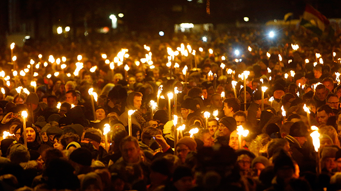 People hold candles during a memorial service is held for those killed on Saturday by a 22-year-old gunman, in Copenhagen February 16, 2015. (Reuters / Hannibal Hanschke)