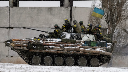 Members of the Ukrainian armed forces ride on a military vehicle near Debaltseve, eastern Ukraine February 16, 2015.(Reuters / Gleb Garanich)