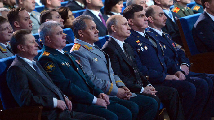 February 20, 2015. President Vladimir Putin, front fourth left, at a gala marking the Defender of the Fatherland Day at the Grand Kremlin Palace. Left: Presidential Chief of Staff Sergei Ivanov. Third left: Defense Minister Sergei Shoigu.(RIA Novosti / Alexei Druzhinin)