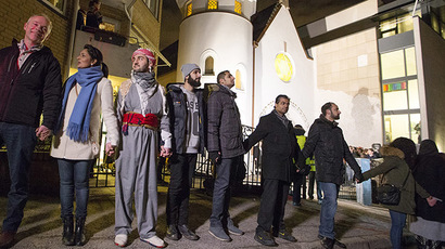 Muslims join hands to form a human shield as they stand outside a synagogue in Oslo February 21, 2015. (Reuters/Hakon Mosvold Larsen/NTB Scanpix)