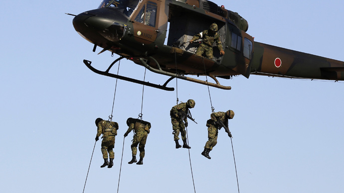 Members of Japan's Ground Self-Defense Force 1st Airborne Brigade rappel from a UH1J Helicopter during an annual new year military exercise at Narashino exercise field in Funabashi, east of Tokyo January 11, 2015. (Reuters / Yuya Shino)