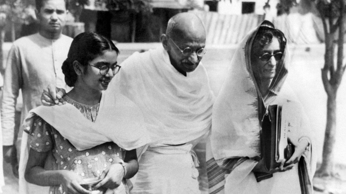 Undated picture taken in New Delhi of Gandhi, known as the Mahatma (1869-1948), Indian nationalist leader and founder of the Indian National Congress, advocating a policy of non-violent non-cooperation to achieve independence of India, walking with Manu Gandhi (L), his grand-daughter. (AFP Photo)