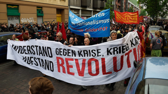 Protesters take part in the 'Revolutionary' May Day demonstration on May 1, 2014 in Berlin. (AFP Photo / Odd Andersen)
