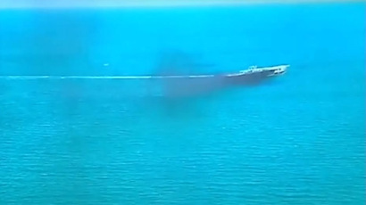 A still from a news broadcast by Press TV showing the Iranian navy blowing up a 'mock' US aircraft carrier.
