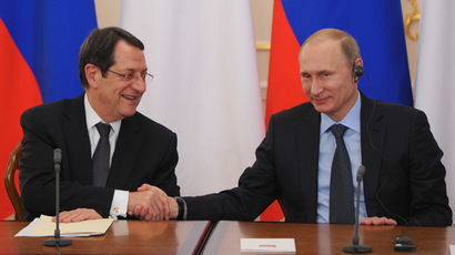 Russian President Vladimir Putin, right, and Cypriot President Nicos Anastasiades during a joint news conference following Russian-Cypriot talks at the Novo-Ogaryovo residence, 25 February, 2015. (RIA Novosti/Michael Klimentyev)