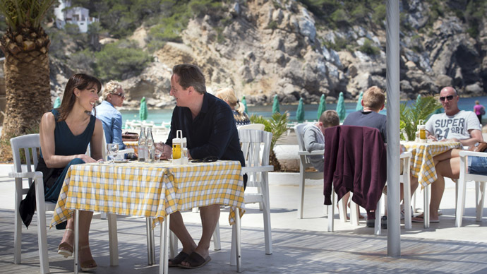 Britain's Prime Minister David Cameron and his wife Samantha take a drink by a beach during their holiday on the Spanish Balearic island of Ibiza May 26, 2013. (Reuters/Stefan Rousseau)
