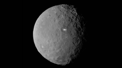 This image was taken by NASA's Dawn spacecraft of dwarf planet Ceres on Feb. 19 from a distance of nearly 29,000 miles (46,000 kilometers). It shows that the brightest spot on Ceres has a dimmer companion, which apparently lies in the same basin (Image from nasa.gov)