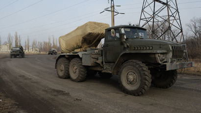 BM-21 Grad multiple rocket launcher systems are withdrawn from Donetsk towards Amvrosievka as part of Minsk Agreements implementation. (RIA Novosti/Mikhail Voskresenskiy)