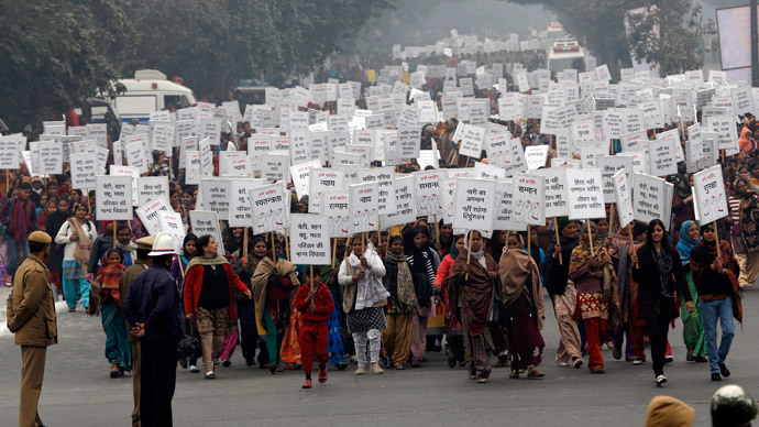 Women hold placards as they march during a rally organized by Delhi Chief Minister Sheila Dikshit (unseen) protesting for justice and security for women, in New Delhi January 2, 2013.(Reuters / Adnan Abidi)